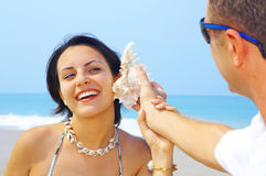 Sound check. A portrait of attractive couple having fun on the beach Stock Images