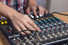 Sound console. Male Hands operating small Sound console on the table Royalty Free Stock Photography