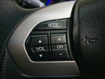Sound control botton on steering wheel. Sound control botton Royalty Free Stock Photos