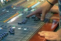 Sound control panel profeshional. Sound control panel professional. Sound designer working on the sound control. Man working on professional digital audio royalty free stock photos