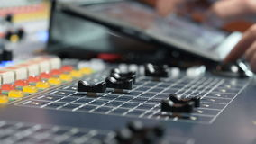 Sound designer working on the sound control stock footage
