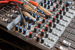 Sound Desk. A sound mixing desk with several leads & cables Stock Photo