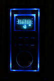 Sound device with display and equalizer. Blue backlight in the dark surroundings Stock Photography