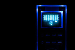 Sound device with display and equalizer. Blue backlight in the dark surroundings Royalty Free Stock Photography
