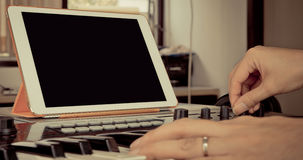 Sound engineer adjusting control on music station Stock Image