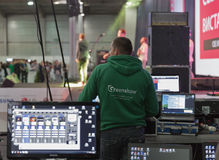 Sound engineer at CEE 2015, the largest. Sound engineer works with mixing console during rock band performance at CEE 2015, the largest electronics trade show of Stock Photography