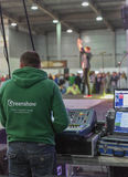 Sound engineer at CEE 2015, the largest. Sound engineer works with mixing console during rock band performance at CEE 2015, the largest electronics trade show of Royalty Free Stock Image