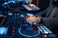 Sound engineer hands over the remote control panel. In the recording studio. Musician at the mixer, professional audio mixing royalty free stock photo