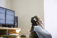Sound Engineer Listening To Music Royalty Free Stock Photo