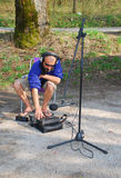 Sound Engineer on Location, Slovenia. A sound engineer at work during on location sound recording by a river in Slovenia Royalty Free Stock Image