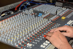 Sound engineer at the mixer - close-up stock photography