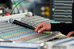 Sound engineer at mixing desk Royalty Free Stock Images