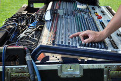 Sound engineer at mixing desk Royalty Free Stock Photo