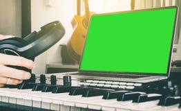 Sound engineer pickup headphone in studio Royalty Free Stock Photo