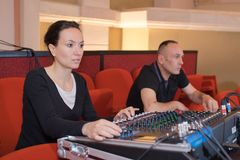 Sound engineer at studio mixing desk Stock Images