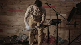 The sound engineer unravels the wires of musical instruments stock footage