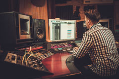 Sound engineer working in boutique recording studio. Stock Images