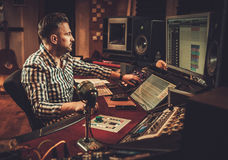 Sound engineer working in boutique recording studio. Stock Photo