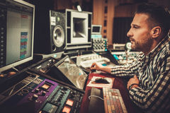 Sound engineer working in boutique recording studio. Stock Photos