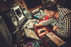 Sound engineer working in boutique recording studio. Sound engineer working in boutique recording studio Royalty Free Stock Images