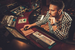 Sound engineer working in boutique recording studio. Stock Image