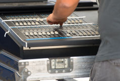 Sound engineer working on mixer Stock Photo