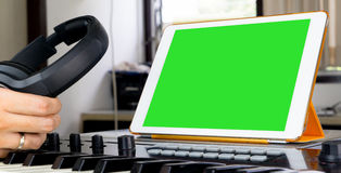 Sound engineer working on music work station. Sound engineer working on tablet music work station Stock Photos
