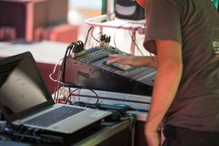 Sound Engineer works with Professional Sound System Mixing Audio Musical Equipment Board.  Stock Photography