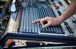 Sound engineer works with sound mixer. Hands close-up Royalty Free Stock Image