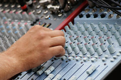 Sound engineer works with sound mixer Royalty Free Stock Images