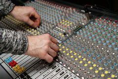 Sound engineer works with sound mixer Royalty Free Stock Image