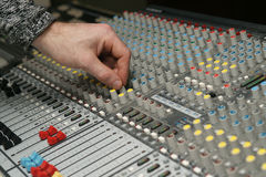 Sound engineer works with sound mixer Stock Image