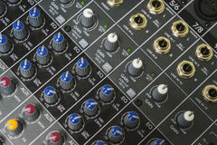 Sound equipment for a nightclub, discotheque or recording studio. The mixing console of the sound engineer in operation. Royalty Free Stock Photography