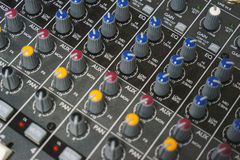 Sound equipment for a nightclub, discotheque or recording studio. The mixing console of the sound engineer in operation. Stock Photography