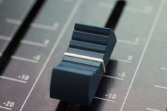 Sound fader. Blue sound fader close-up Stock Image