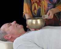 Sound Healer working with Tibetan Singing Bowl Stock Images