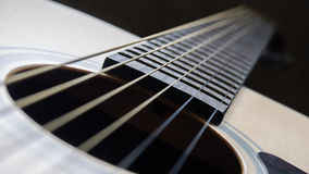 Sound hole and strings of acoustic guitar. Close up shot sound hole and strings of acoustic guitar Stock Image