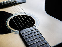 Sound hole and strings of acoustic guitar Stock Images