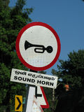 Sound Horn Sign. Roadside sign requesting drivers to sound horn in India Royalty Free Stock Photo