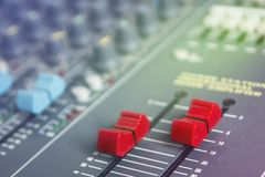 Sound Level Control Slider. Red telescopic audio mixer on the console floor royalty free stock photo