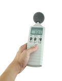 Sound level meter. Holding on hand stock images