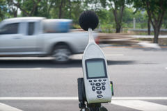Sound level meter. Measuring the noise of cars on the road with a sound level meter royalty free stock photo