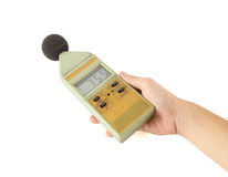 Sound level meter on white background. Old sound level meter holding on hand stock image