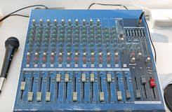Sound levels on a professional audio mixer with microphone, Music control panel.  royalty free stock image
