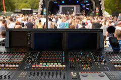 Sound and lighting desk at an outdoor festival concert Stock Photography