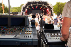 Sound and lighting desk at an outdoor festival concert Stock Photos