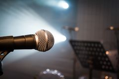 Sound microphone music notes and studio lights are ready stock photography