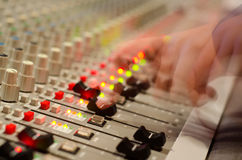 Sound mix board. Sound engineer's hand moving on sound mixing board Stock Photos