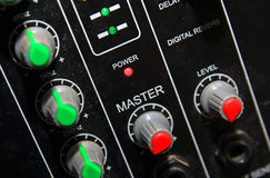 Sound mixer. Details of a black electronic sound mixer Stock Photo