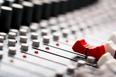 Sound mixer. Red fader ahead Royalty Free Stock Photos